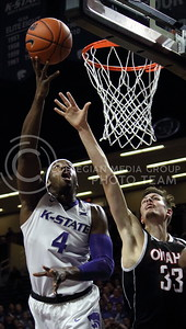 Senior forward D.J. Johnson goes up for a shot during the K-State basketball game against the University of Nebraska-Omaha in Bramlage Coliseum on Nov. 15, 2016. (Miranda Snyder | The Collegian)