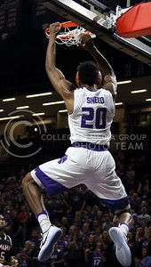 Freshman forward Xavier Sneed scores a basket during the K-State basketball game against the University of Nebraska-Omaha in Bramlage Coliseum on Nov. 15, 2016. (Miranda Snyder | The Collegian)