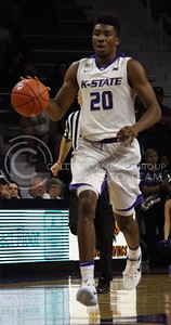 Freshman forward Xavier Sneed dribbles the ball during the K-State basketball game against the University of Nebraska-Omaha in Bramlage Coliseum on Nov. 15, 2016. (Miranda Snyder | The Collegian)