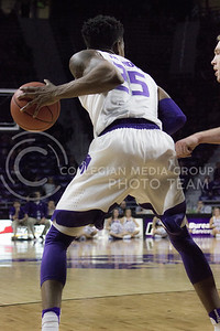 Senior forward Wesley Iwundu looks to pass the ball during the K-State basketball game against the University of Nebraska-Omaha in Bramlage Coliseum on Nov. 15, 2016. (Kelly Pham | The Collegian)