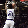 Freshman forward Xavier Sneed dunks during the K-State basketball game against the University of Nebraska-Omaha in Bramlage Coliseum on Nov. 15, 2016. (Kelly Pham | The Collegian)