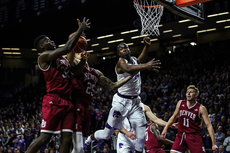 Forward Makol Mawien attempts to block the ball at the game against Denver University. The cats beat the denver boone's 64-56. (Emily Lenk | Collegian Media Group)