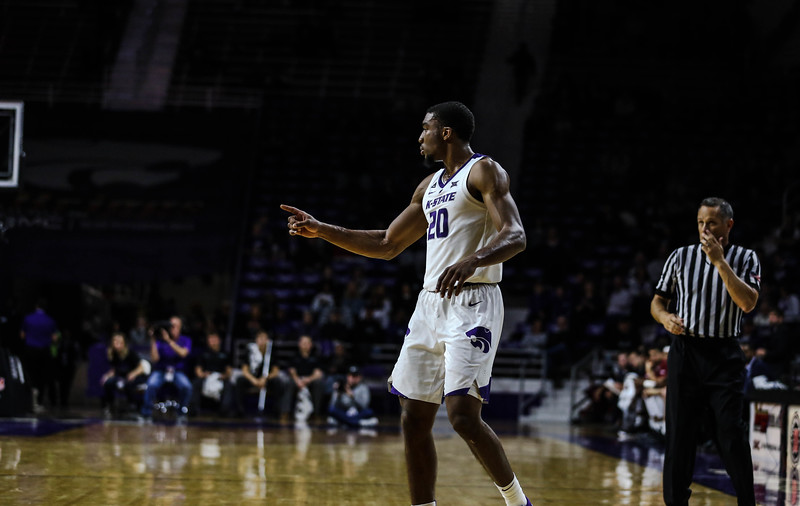 Xavier Sneed points to a teammate during K-State's basketball game against Denver in Bramlage Coliseum on Nov. 12, 2018. The Wildcats defeated the Pioneers 64-56. (Emily Lenk | Collegian Media Group)