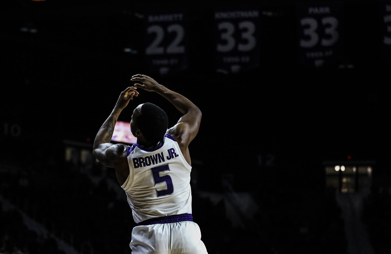 Senior guard Barry Brown Jr. jumps to catch the ball during K-State's basketball game against Denver in Bramlage Coliseum on Nov. 12, 2018. The Wildcats defeated the Pioneers 64-56. (Emily Lenk | Collegian Media Group)