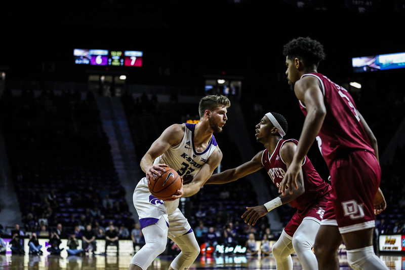 Dean Wade prepares to make his way past to shoot the ball during K-State's basketball game against Denver in Bramlage Coliseum on Nov. 12, 2018. The Wildcats defeated the Pioneers 64-56. (Emily Lenk | Collegian Media Group)