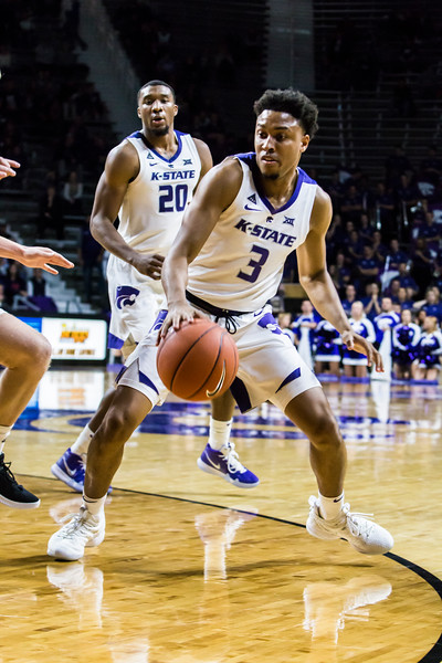 Senior guard Kamau Stokes scans the court for an open play during K-State's basketball game against Denver in Bramlage Coliseum on Nov. 12, 2018. The Wildcats defeated the Pioneers 64-56. (Logan Wassall | Collegian Media Group)