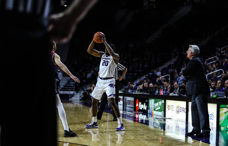 Xavier Sneed passes the ball to a teammate during K-State's basketball game against Denver in Bramlage Coliseum on Nov. 12, 2018. The Wildcats defeated the Pioneers 64-56. (Emily Lenk | Collegian Media Group)
