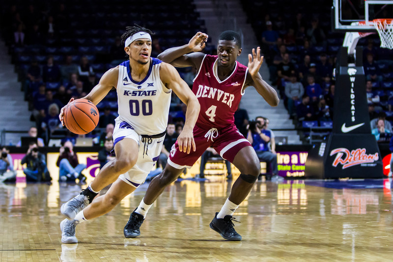 Sophomore guard Mike McGuirl charges the basket during K-State's basketball game against Denver in Bramlage Coliseum on Nov. 12, 2018. The Wildcats defeated the Pioneers 64-56. (Logan Wassall | Collegian Media Group)