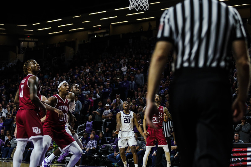 Xavier Sneed makes an expression after the Wildcats score during K-State's basketball game against Denver in Bramlage Coliseum on Nov. 12, 2018. The Wildcats defeated the Pioneers 64-56. (Emily Lenk | Collegian Media Group)