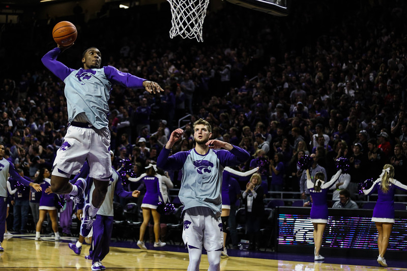Forward Xavier Sneed and Dean Wade practice shooting and dunking with the rest of the team before the game against Denver University. The cats beat the Denver Boone's 64-56. (Emily Lenk | Collegian Media Group)