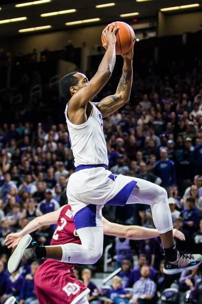 Senior guard Barry Brown Jr. leaps up to dunk the ball during K-State's basketball game against Denver in Bramlage Coliseum on Nov. 12, 2018. The Wildcats defeated the Pioneers 64-56. (Logan Wassall | Collegian Media Group)
