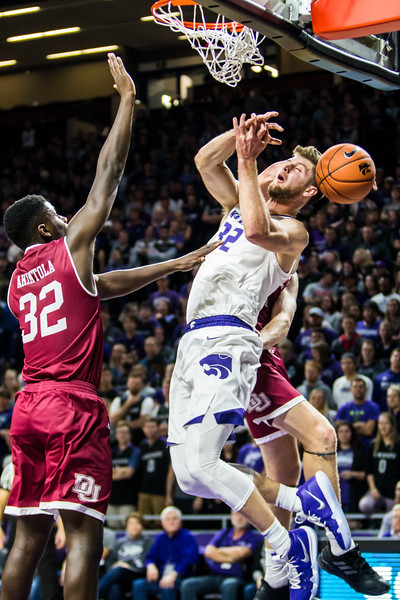 Senior forward Dean Wade falls back as his shot is blocked during K-State's basketball game against Denver in Bramlage Coliseum on Nov. 12, 2018. The Wildcats defeated the Pioneers 64-56. (Logan Wassall | Collegian Media Group)
