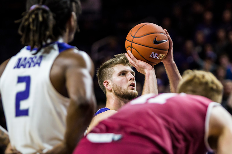 Senior forward Dean Wade perepares to shoot a free throw during K-State's basketball game against Denver in Bramlage Coliseum on Nov. 12, 2018. The Wildcats defeated the Pioneers 64-56. (Logan Wassall | Collegian Media Group)