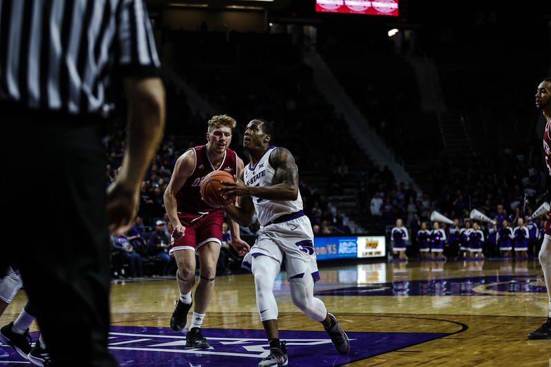 Senior guard Barry Brown Jr. charges the basket during K-State's basketball game against Denver in Bramlage Coliseum on Nov. 12, 2018. The Wildcats defeated the Pioneers 64-56. (Emily Lenk | Collegian Media Group)
