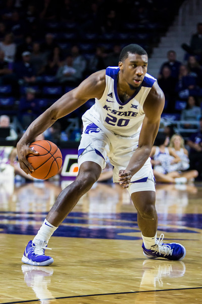 Junior forward Xavier Sneed scans the court as he looks for an open teammate during K-State's basketball game against Denver in Bramlage Coliseum on Nov. 12, 2018. The Wildcats defeated the Pioneers 64-56. (Logan Wassall | Collegian Media Group)