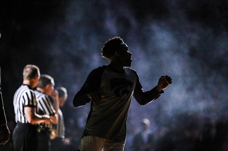 Kamau Stokes runs out in smoke as the game against Denver University begins. The cats beat the Denver Boone's 64-56. (Emily Lenk | Collegian Media Group)