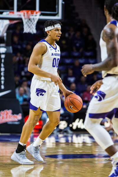 Sophomore guard Mike McGuirl scans the court for an open teammate during K-State's basketball game against Denver in Bramlage Coliseum on Nov. 12, 2018. The Wildcats defeated the Pioneers 64-56. (Logan Wassall | Collegian Media Group)