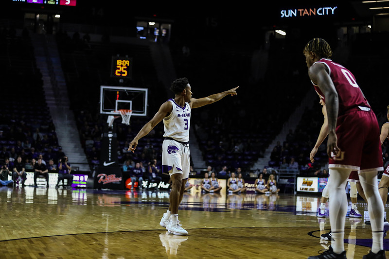 Kamau Stokes points to a teammate during the game against Denver University begins. The cats beat the Denver Boone's 64-56. (Emily Lenk | Collegian Media Group)