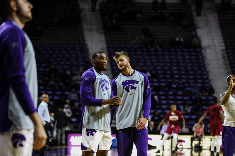 Forward Xavier Sneed talks with Dean Wade before the game against Denver University. The cats beat the Denver Boone's 64-56. (Emily Lenk | Collegian Media Group)