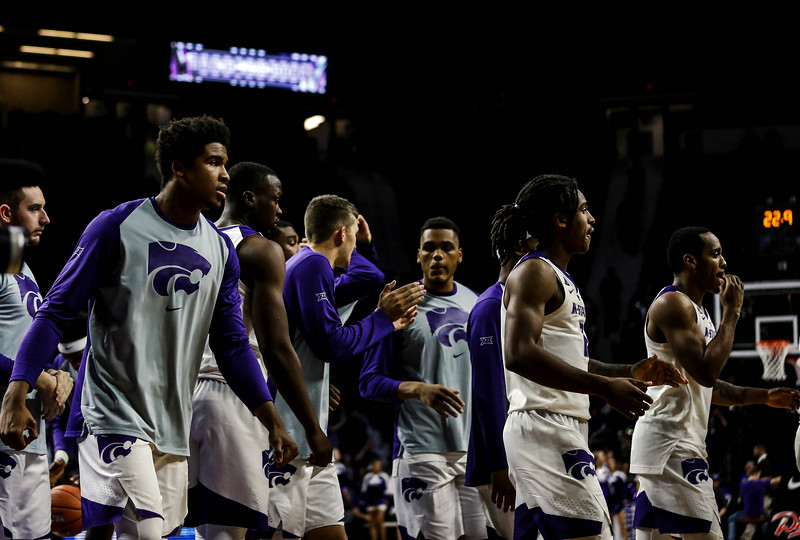 The Wildcats walk back to the benches during K-State's basketball game against Denver in Bramlage Coliseum on Nov. 12, 2018. The Wildcats defeated the Pioneers 64-56. (Emily Lenk | Collegian Media Group)