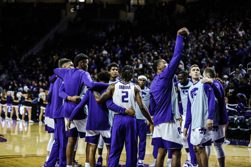 The team meets in a huddle before the game against Denver University. The cats beat the Denver Boone's 64-56. (Emily Lenk | Collegian Media Group)