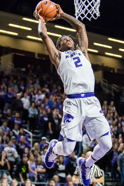 Sophomore guard Cartier Diarra goes up for a dunk in K-State's men's basketball game against Pittsburg State in Bramlage Coliseum on Nov. 2, 2018. The Wildcats took the Gorillas 79-39. (Logan Wassall | Collegian Media Group)