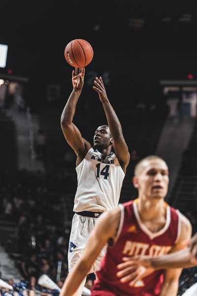 """Towering above the defense, K-State 6'9"""" junior Makol Mawien shoots and scores against Pittsburg State. Mawien scored a total of 6 points during the game on November 2, 2018. (Alex Todd 