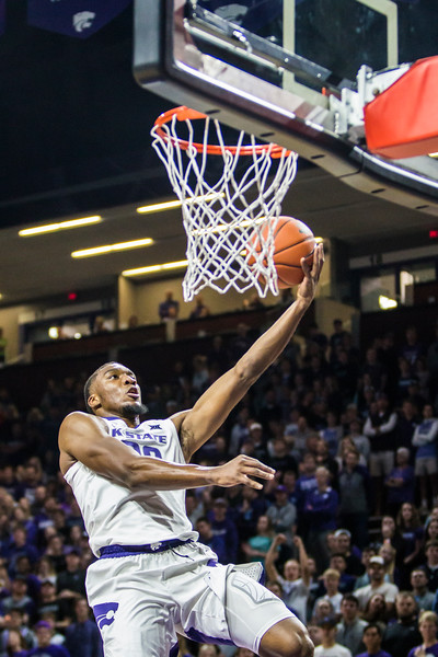 Junior forward Xavier Sneed puts the ball up for a layup in K-State's men's basketball game against Pittsburg State in Bramlage Coliseum on Nov. 2, 2018. The Wildcats took the Gorillas 79-39. (Logan Wassall | Collegian Media Group)