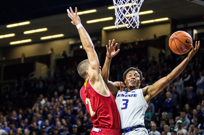 Senior guard Kamau Stokes is fouled as he goes for a breakaway layup in K-State's men's basketball game against Pittsburg State in Bramlage Coliseum on Nov. 2, 2018. The Wildcats took the Gorillas 79-39. (Logan Wassall | Collegian Media Group)