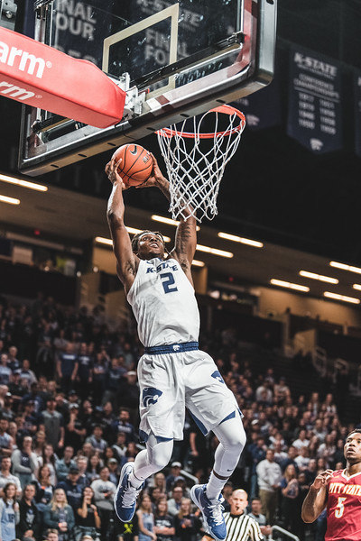 Smile on his face, Cartier Diarra performs his second dunk of the night against Pittsburg State. Diarra scored a total of 9 points during the game on November 2, 2018. (Alex Todd | Collegian Media Group)