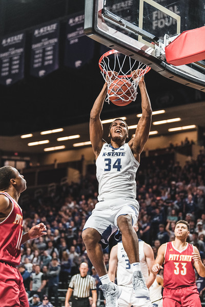 With a smile on his face, K-State forward Levi Stockard III continues the slam dunk trend against Pittsburg State on November 2, 2018. K-State won 79-39 in Bramlage Coliseum. (Alex Todd | Collegian Media Group)