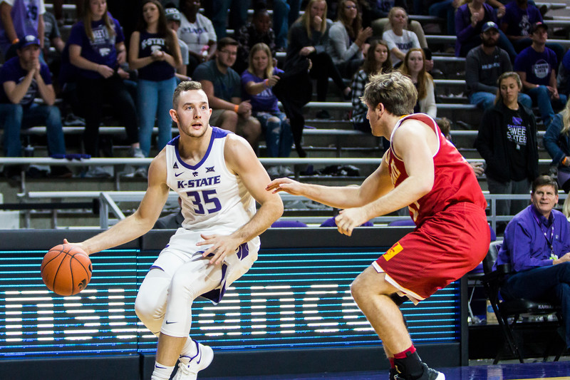 Junior forward Patrick Muldoon scans the court for an open teammate during K-State's men's basketball game against Pittsburg State in Bramlage Coliseum on Nov. 2, 2018. The Wildcats took the Gorillas 79-39. (Logan Wassall | Collegian Media Group)