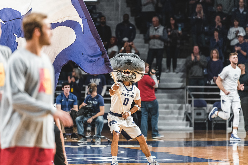 Waving the K-State flag, Willie pumps up the crowd for Friday nights basketball game against Pittsburg State. K-State won 79-39 in Bramlage Coliseum. (Alex Todd | Collegian Media Group)
