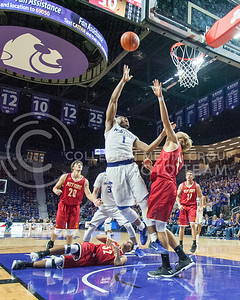 Cable Ervin II, senior guard, looks for a layup while Pittsburg State contests the ball during the Wildcats game in Bramlage Coliseum on Oct. 28, 2016. (Evert Nelson | The Collegian)