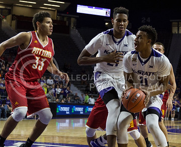 Freshman guard Brian Patrick looks for an open spot to pass during the K-State game against Pittsburg State in Bramlage Coliseum on Oct. 28, 2016. (Nathan Jones | The Collegian)