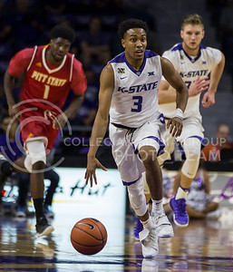 Sophomore guard Kamau Stokes runs the ball down the court during the K-State game against Pittsburg State in Bramlage Coliseum on Oct. 28, 2016. (Nathan Jones | The Collegian)