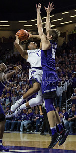 Senior guard Carlbe Ervin II makes a shot on the basket during the K-State game against TCU in Bramlage Coliseum on Feb. 1, 2017. (Nathan Jones | The Collegian)