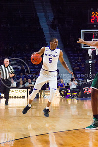 Sophomore guard Barry Brown drives down the court during the basketball game between K-State and Green Bay in Bramlage Coliseum on Nov. 30, 2016. (Kelly Pham   The Collegian)