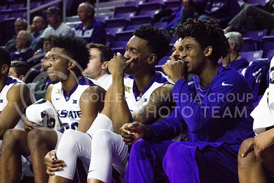 Players Xavier Sneed, Wesley Iwundu and Cartier Diarra react during the basketball game between K-State and Green Bay in Bramlage Coliseum on Nov. 30, 2016. (Kelly Pham   The Collegian)