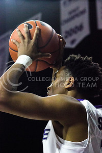 Sophomore guard Kamau Stokes looks for an open player during the basketball game between K-State and Green Bay in Bramlage Coliseum on Nov. 30, 2016. (Kelly Pham   The Collegian)