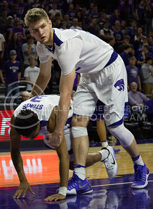 Sophomore forward Dean Wade helps sophomore guard Kamau Stokes off the ground during the K-State basketball game against Green Bay in Bramlage Coliseum on Nov. 30, 2016. (Miranda Snyder   The Collegian)