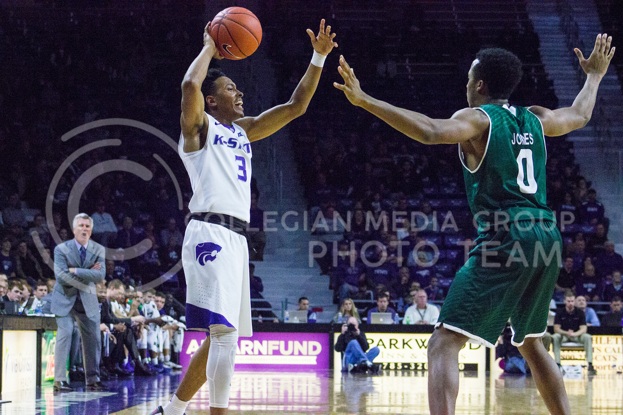 Sophomore guard Kamau Stokes yells out a play to his teammates during the K-State basketball game against Green Bay in Bramlage Coliseum on Nov. 30, 2016. (Kelly Pham | The Collegian)