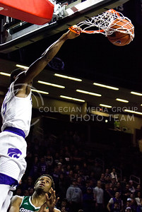 Sophomore guard Barry Brown dunks the ball during the basketball game between K-State and Green Bay in Bramlage Coliseum on Nov. 30, 2016. (Kelly Pham   The Collegian)