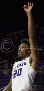 Freshman forward Xavier Sneed holds up three fingers as a teammate scores three points during the K-State basketball game against Green Bay in Bramlage Coliseum on Nov. 30, 2016. (Miranda Snyder   The Collegian)