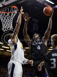 Senior forward D.J. Johnson makes a shot on the basket during the K-State game against West Virginia in Bramlage Coliseum on Jan. 21, 2017. (Nathan Jones | The Collegian)