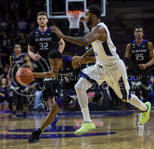 Sophomore guard Kamau Stokes runs the ball down the court during the K-State game against West Virginia in Bramlage Coliseum on Jan. 21, 2017. (Nathan Jones | The Collegian)