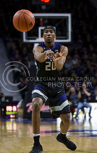 Freshman forward Xavier Sneed passes the ball during the K-State game against West Virginia in Bramlage Coliseum on Jan. 21, 2017. (Nathan Jones | The Collegian)