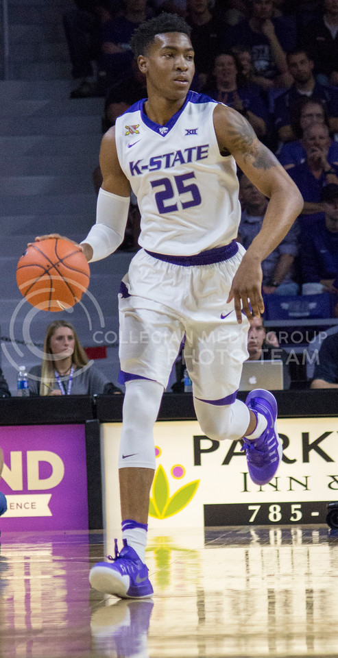 Senior forward Wesley Iwundu dribbles the ball down the court during the K-State game against Washburn in Bramlage Coliseum on Nov. 4, 2016. (Miranda Snyder | The Collegian)