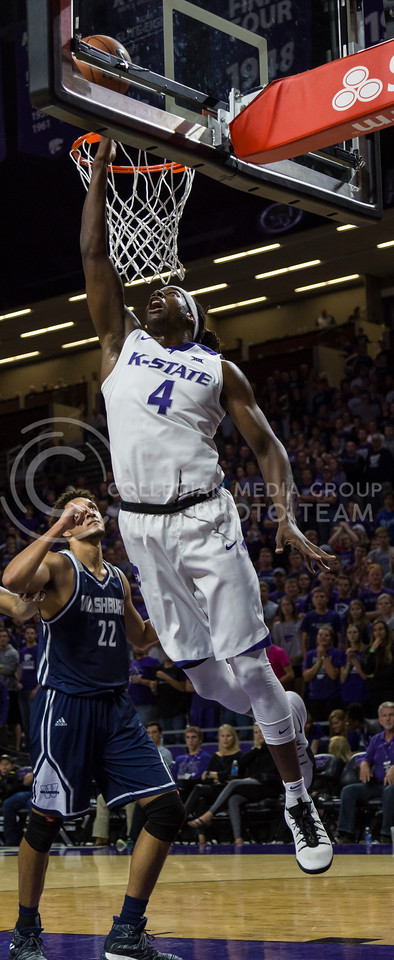 Senior forward D.J. Johnson makes a shot on the basket during the K-State game against Washburn in Bramlage Coliseum on Nov. 4, 2016. (Nathan Jones | The Collegian)