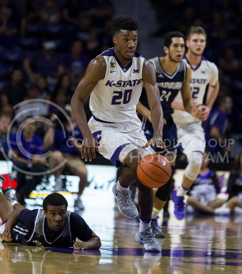 Freshman forward Xavier Sneed runs the ball down the court during the K-State game against Washburn in Bramlage Coliseum on Nov. 4, 2016. (Nathan Jones | The Collegian)